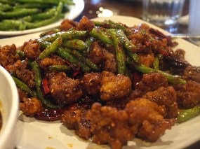 Grand Szechuan: Country Style Chicken. This is not on the menu. Crispy chicken and green beans tossed in a spicy-sweet sauce.