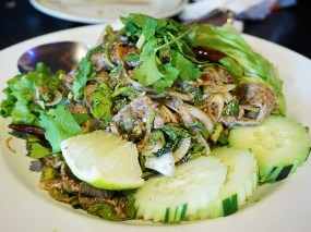 This nam thok, a sliced beef salad, ordered at the same meal was better.