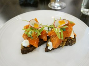 Coho Salmon Tartine: pumpernickel bread, caramelized onion, smoked créme fraîche, snap peas