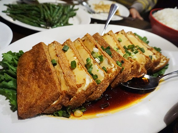 You have to like tofu and you have to like the interplay of crisp and soft textures. The soy sauce is not particular spicy. Another dish that's best got in a large group.