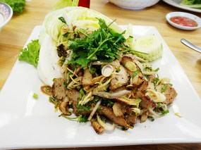 The grilled pork salad varies from very good to blah.