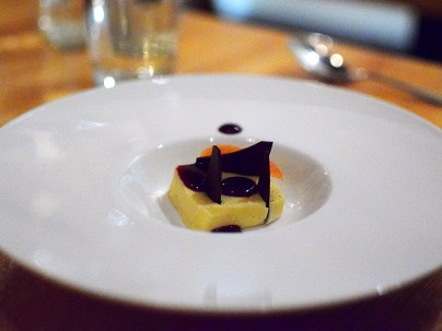 Piccolo: Citrus panna cotta with vanilla, dark chocolate, and fermented huckleberries