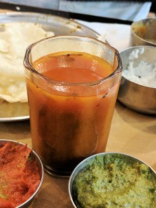 My friend asked for a rasam on the side and it was served in a glass.