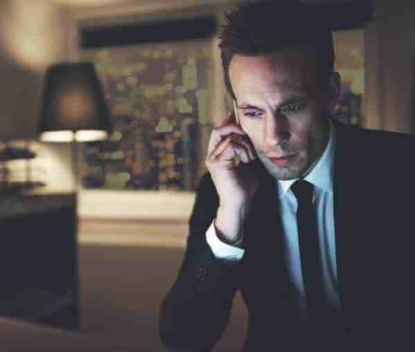 Picture of financial advisor on phone in hotel room