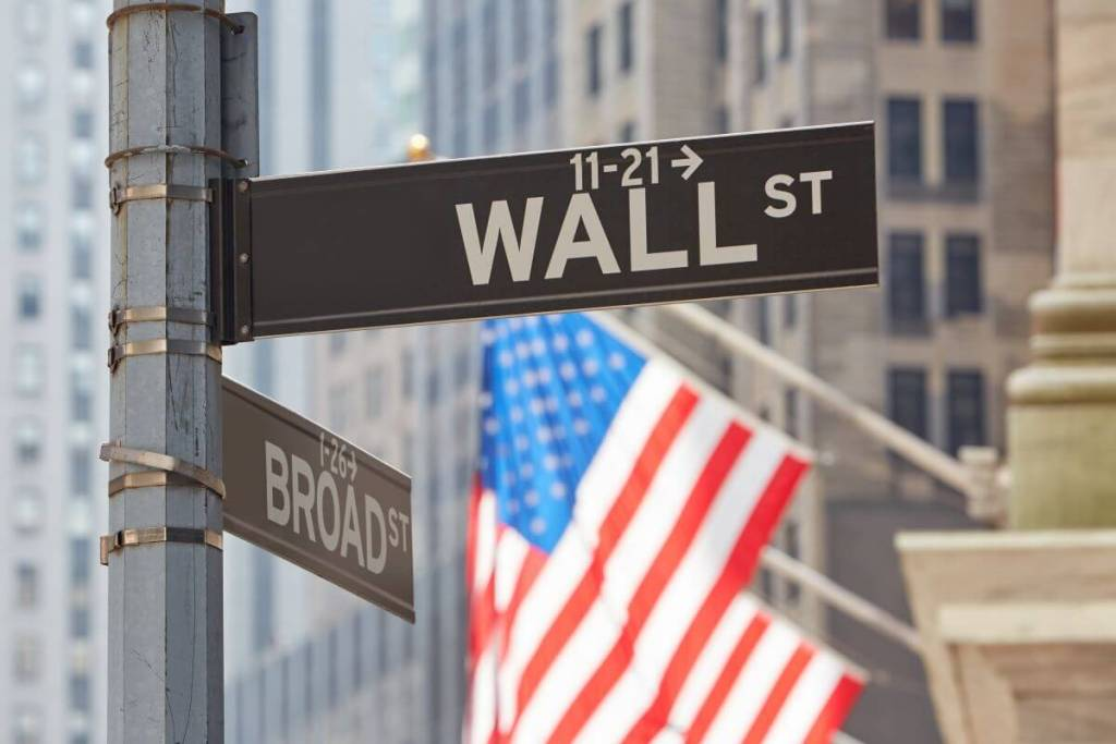Wall Street Sign Near Stock Market with American Flags Index Annuity Stock Market Index List