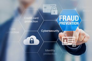 Person in front of screen selecting fraud  prevention icon