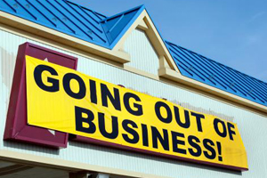 "Retail store with a ""Going Out of Business"" banner in front of it's name"