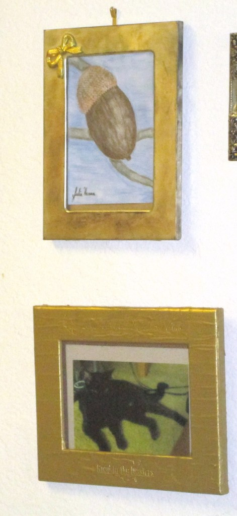 I decided the Irina the cat photograph looks best hanging on the wall next to my colored pencil drawing of an acorn.