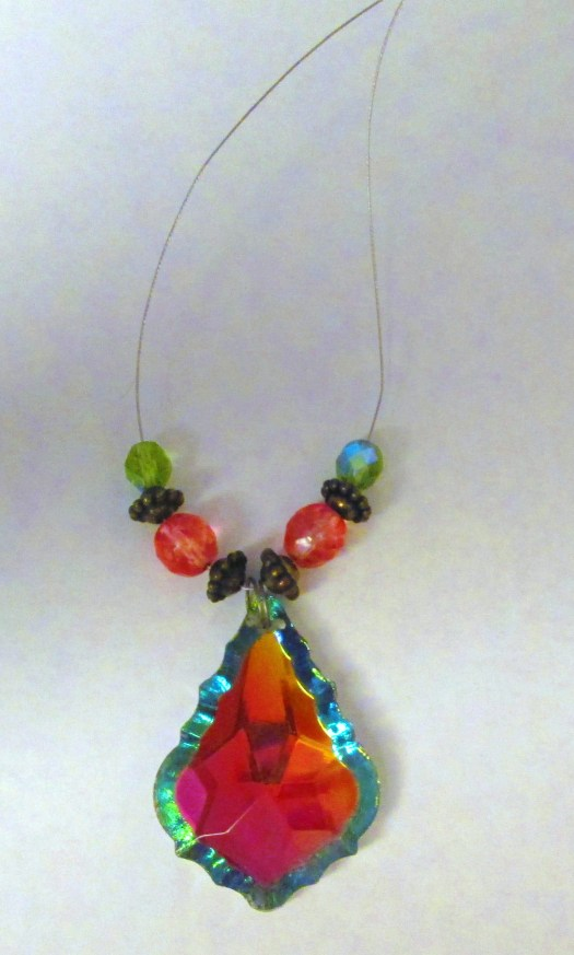 A green bead has been placed on each side of the necklace.