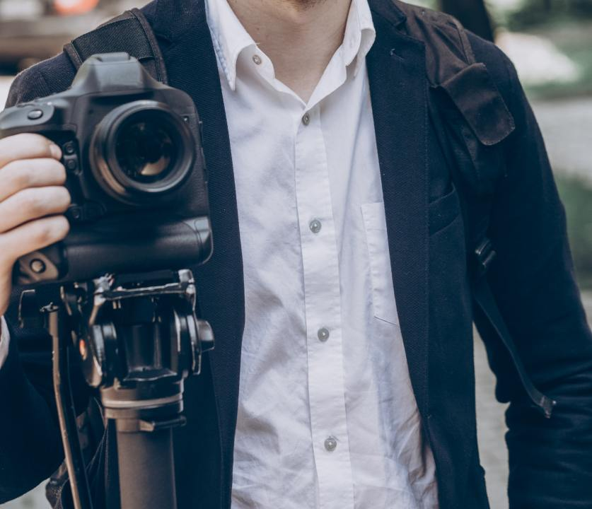 stylish man holding photo camera