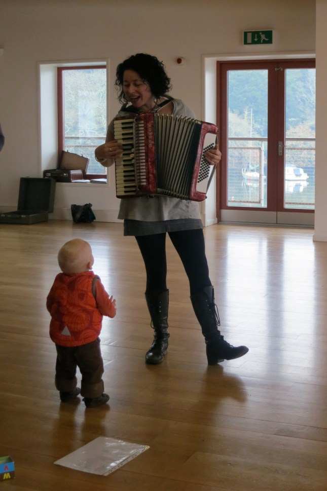 Choir-baby T admiring the playing of the accordion