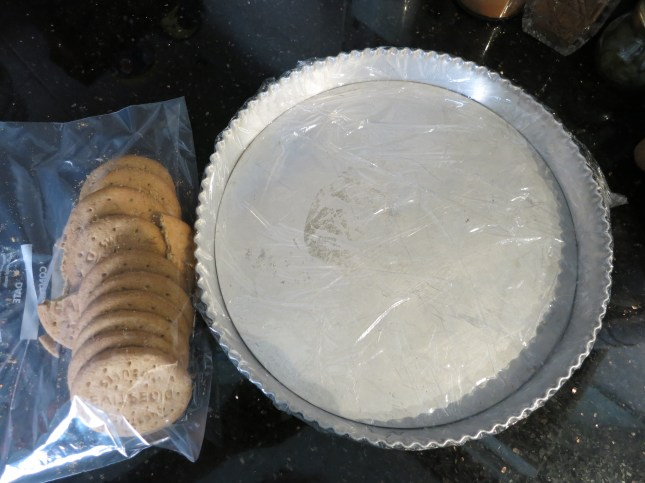 Lined tin and first batch of biscuits ready for bashing