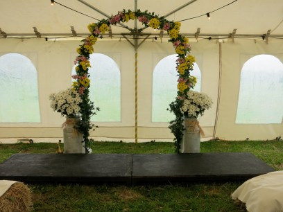Wedding arch and hay bales