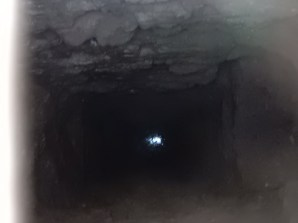 Looking down the shaft to the sea below at full tide