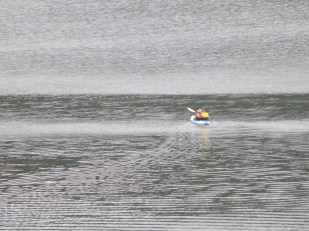 Love the water pattern left by the canoeists and the reflection of the yellow jacket in the water
