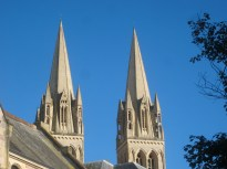 The spires of Truro Cathedral with blue sky