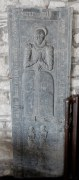 cCrved stone tomb marker