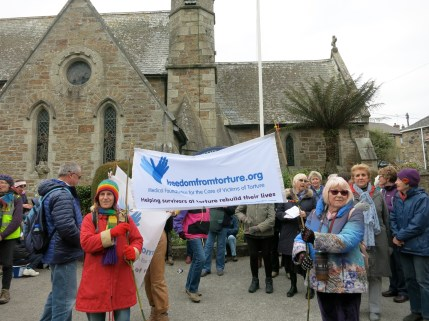Outside St Peter's Church, Newlyn, getting ready to sing 'May This Space be Filled With Joy and Harmony'