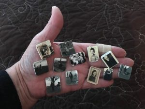 Photo charms held in palm of hand