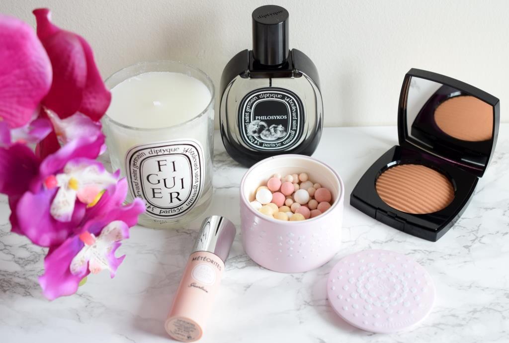 Flatlay makeup Diptyque Guerlain Chanel