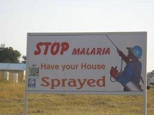 Uma Placa em Zambia África Divulgando a Pulverização Residual de Interiores com DDT