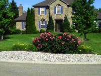Big C Lawn and Landscaping - Ornamental Grasses & Daylily Flowers in River Rock Mulch Bed, 2014 - 21