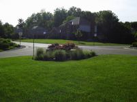 Big C Lawn and Landscaping - Ornamental Grasses & Daylily Flowers in River Rock Mulch Bed, 2014 - 22