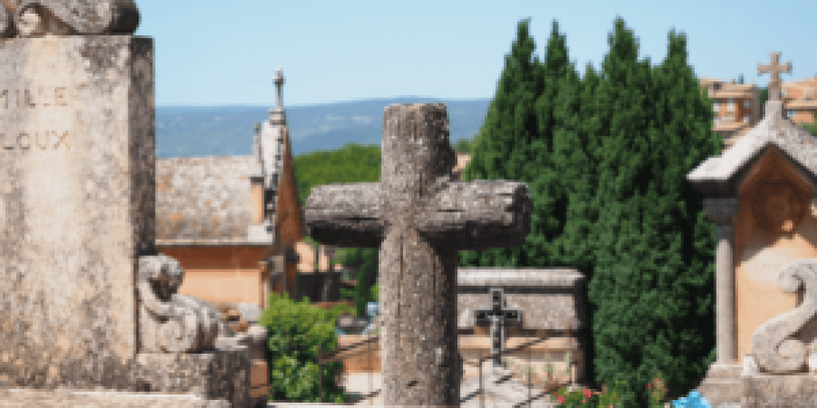 Graveyard with a large wooden cross