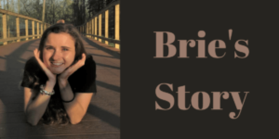 Girl with Face in Hands laying on a bridge
