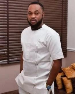 Damola Olatunji in white traditional attire