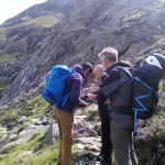 Checking our location before tackling the steep ground