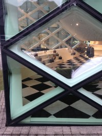 Detail from Prada building with a sneak peak from the interior. Amazing interior...