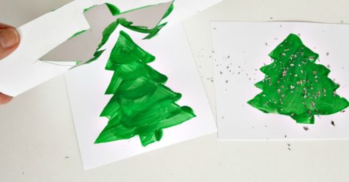 lifting Christmas tree stencils to reveal finished painting