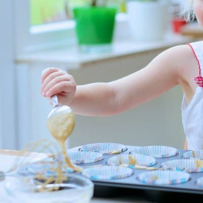 easy berry muffins your toddler can make putting in muffin cases