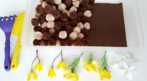 how to set up a spring flowers and pompoms sensory bin activity