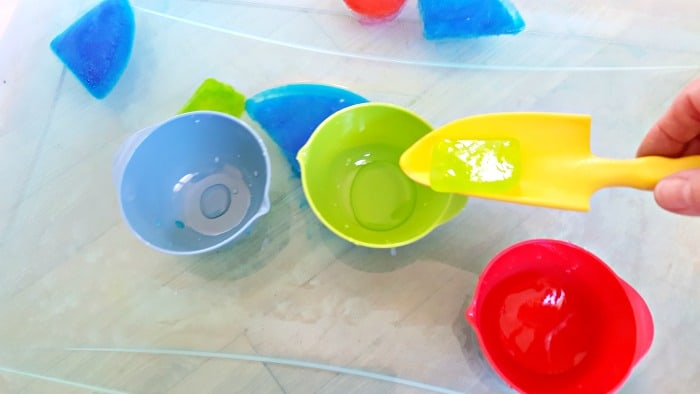 scooping up ice shapes with water tools