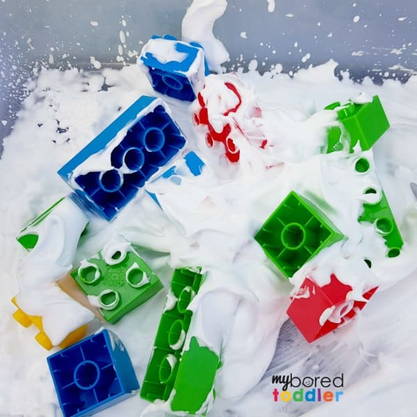 Messy Play with shaving foam or whipped cream and blocks 2