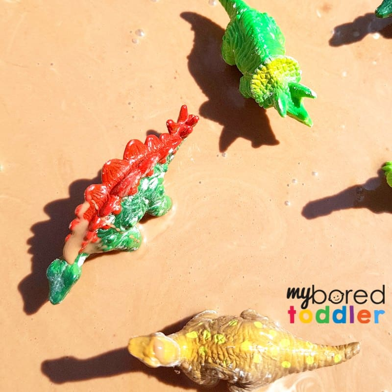 dinosaurs in oobleck muddy puddles sensory bin sensory play for toddlers preschoolers
