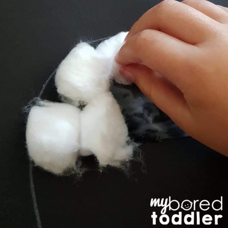 ghost cotton wool craft for toddlers adding cotton balls