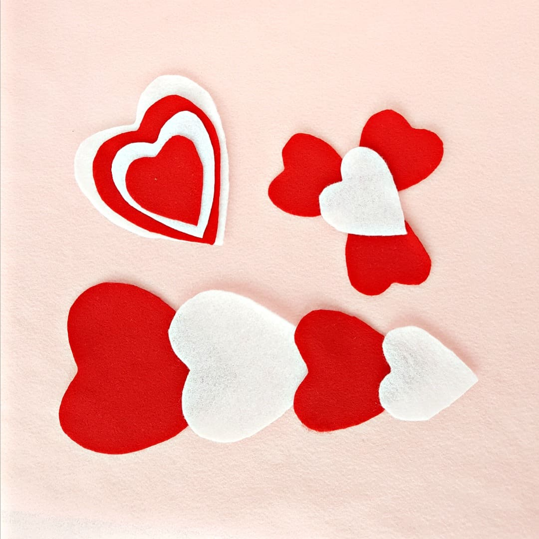 Toddler fine motor activity with felt heart shapes