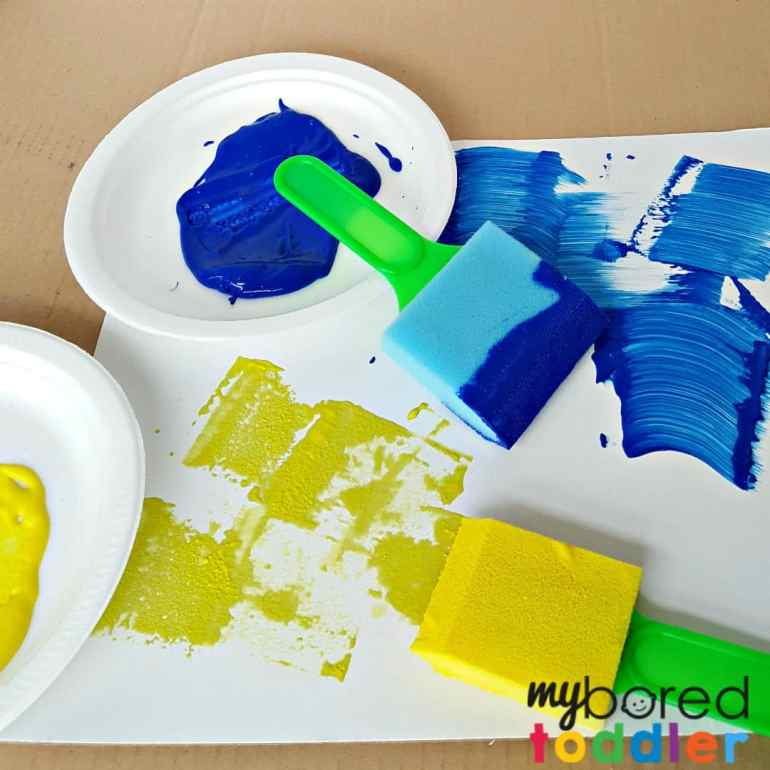 Toddler painting activity using foam brushes square no text