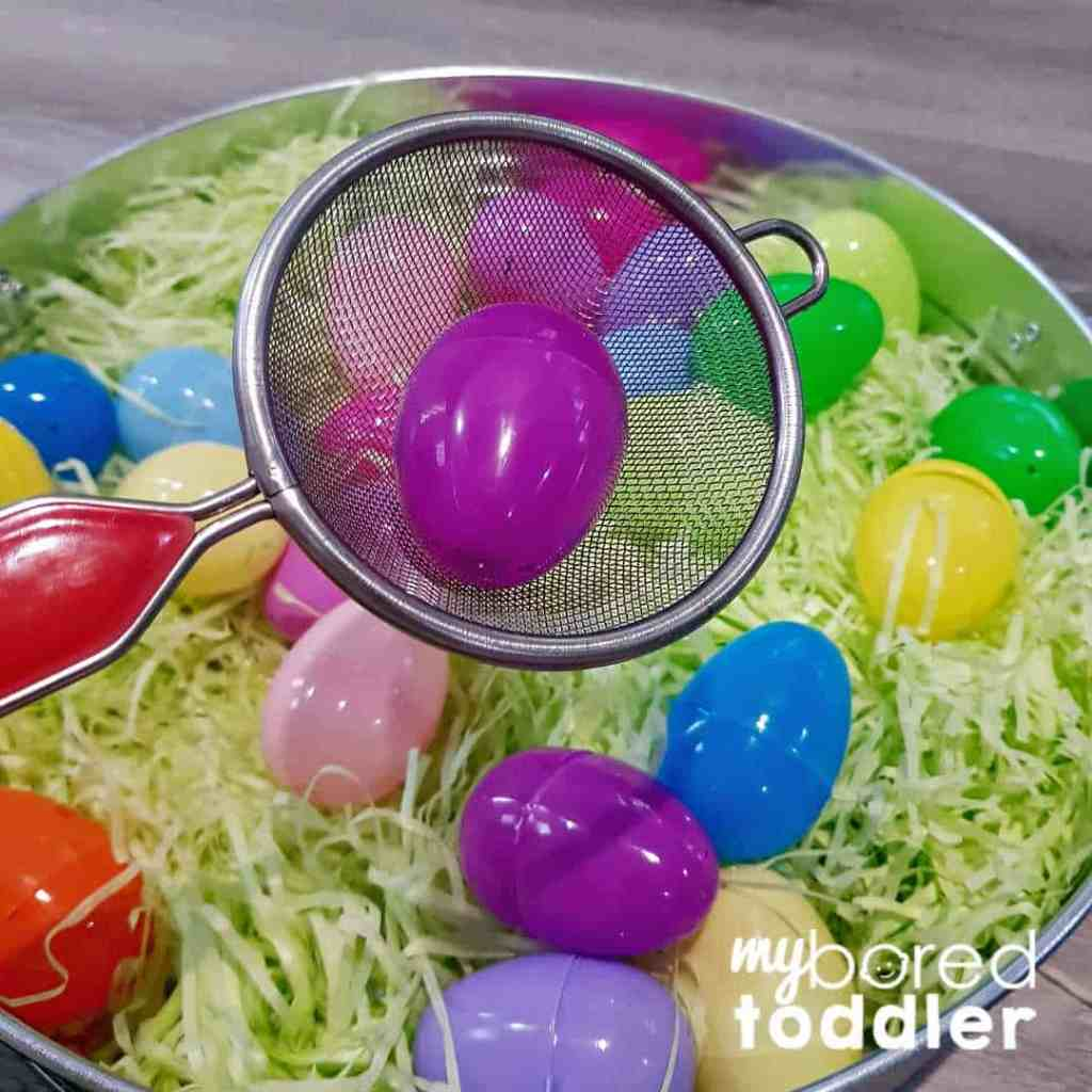 easter egg color hunt sensory bin using a scoop