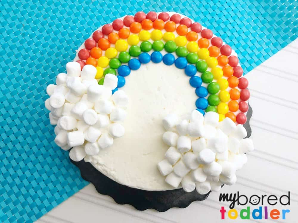 easy rainbow birthday party cake using skittles and marshmallows finished
