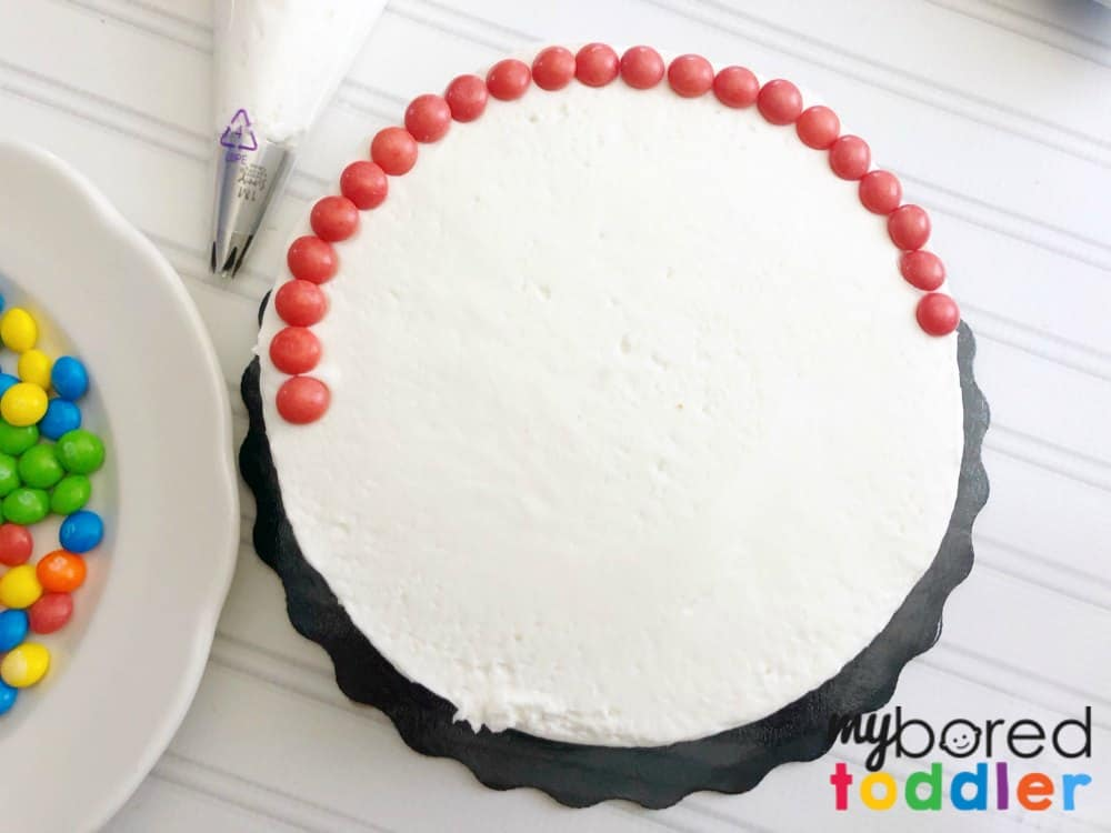 how to make an easy rainbow birthday cake with skittles step 2