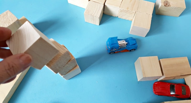 Stacking blocks toddler play