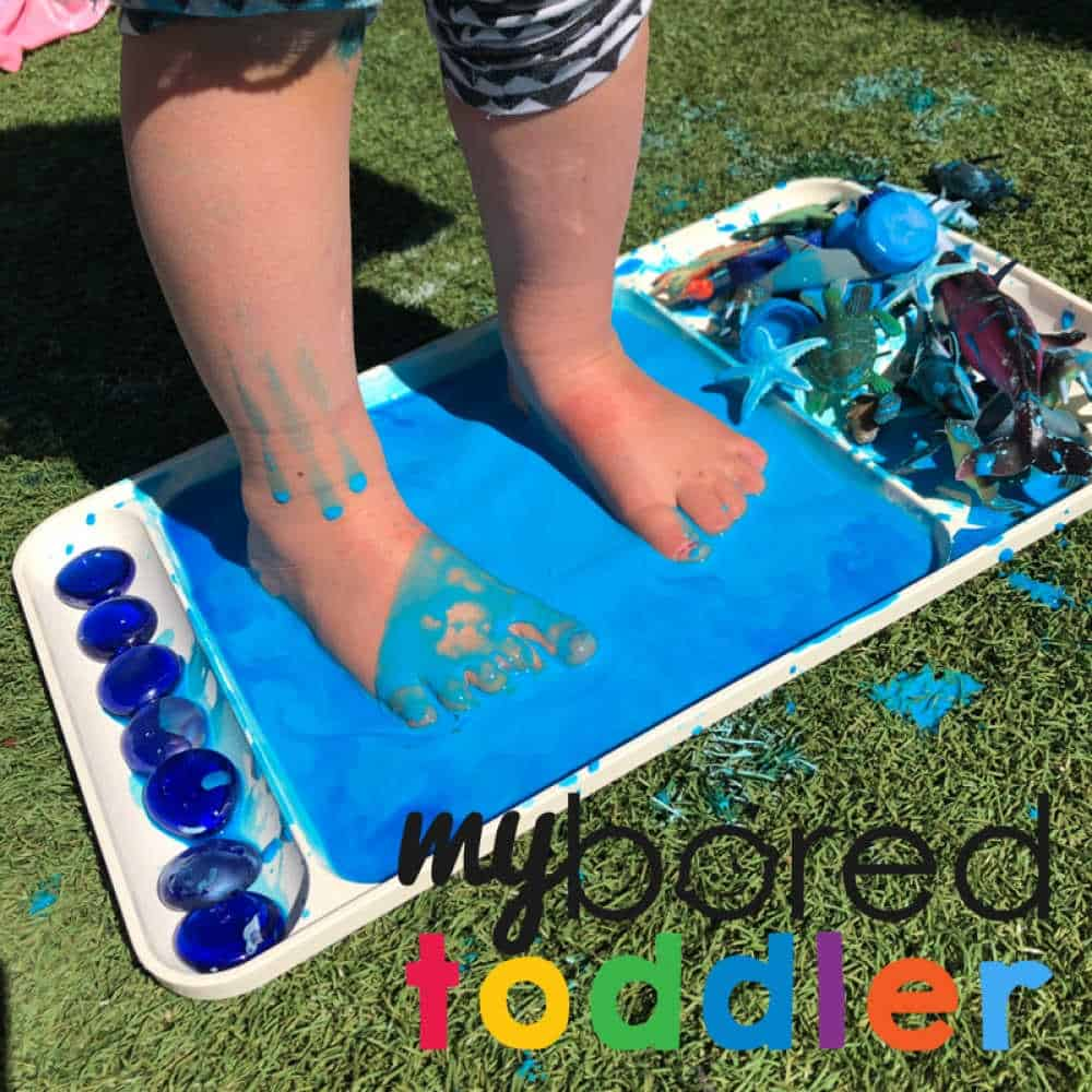 stomping in oobleck messy play sensory fun