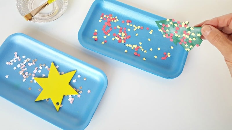 Press the foam cut out onto the confetti in the tray