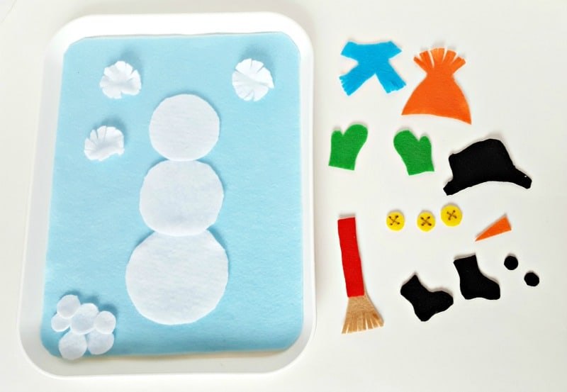 Felt cut outs can be added to a felt snowman for a winter theme toddler activity
