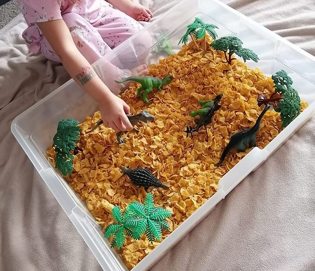 @just_jska cornflakes and dinos sensory bin idea for toddlers