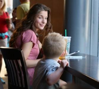 girl smiling at little boy
